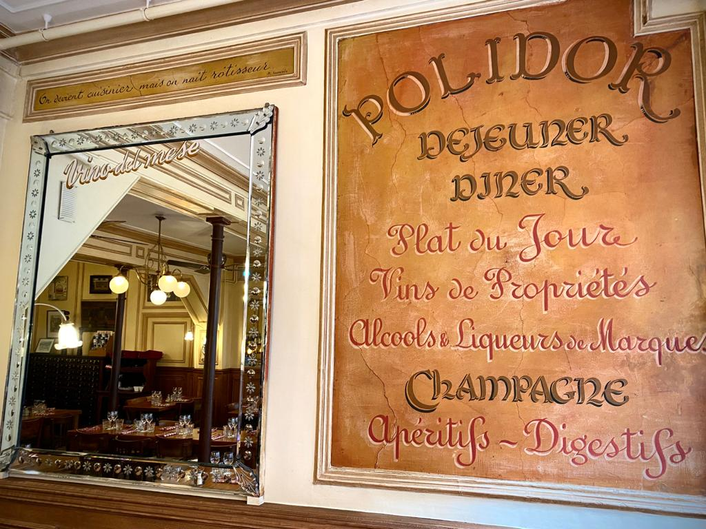 Mirror and old menu at Polidor, historic restaurant in Paris